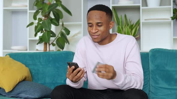 Thumbnail for Online Payment. African-american Man Holding Credit Card and Using Smartphone for Shopping in