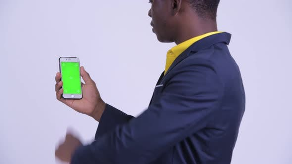 Thumbnail for Rear View of Young African Businessman Using Phone