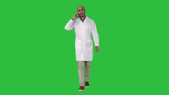 Thumbnail for Professional medical doctor talking on mobile phone while