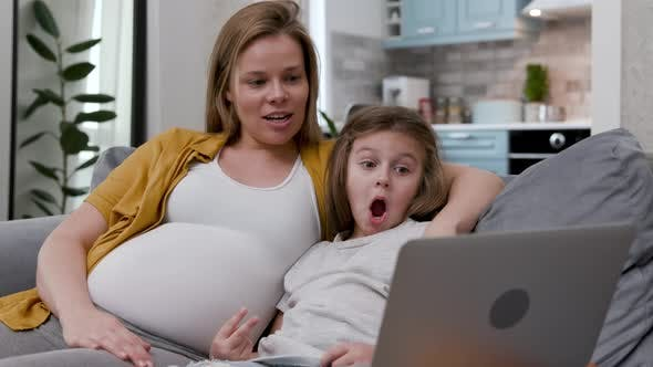 Thumbnail for 30s Young Woman and Cute Little Girl Chatting on Video Call Using Laptop
