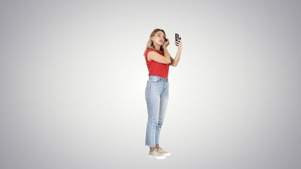 Thumbnail for Pretty young woman applying mascara looking at her phone