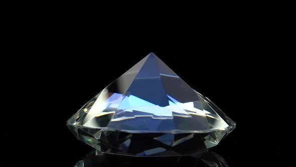 Thumbnail for Diamond Slowly Rotates with a Sharp End Up. Black Background