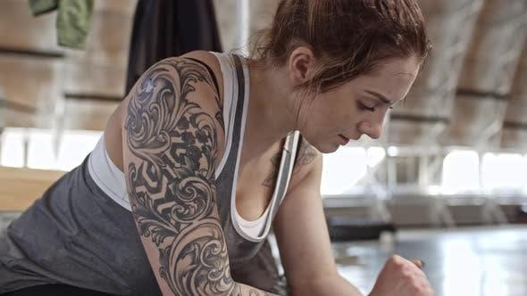 Thumbnail for Female Athlete Taking Break in Gym