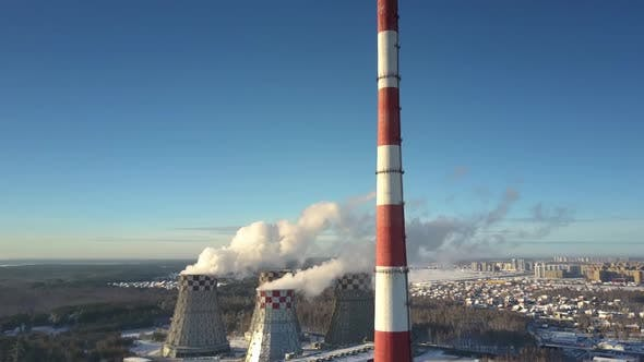 Thumbnail for Aerial View Chimney and Cooling Towers Against Town and Sky