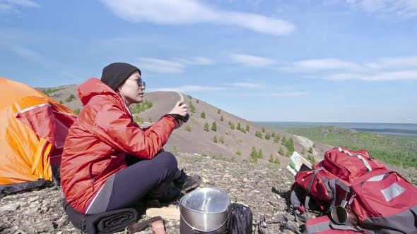 Thumbnail for Female Camper Taking Pictures of Mountains with Camera