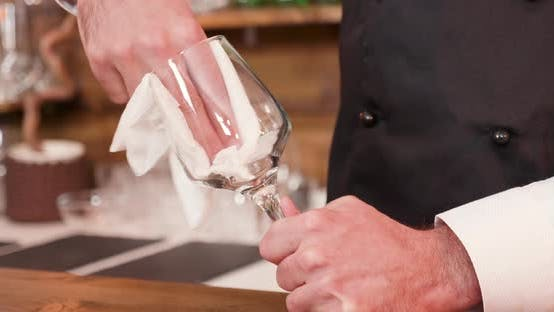 Thumbnail for Closeup of a Mans Hands Cleaning a Glass