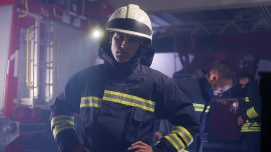 Serious Fireman Looking at Camera