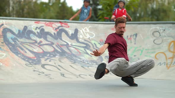 Thumbnail for Man breakdancing on the ground
