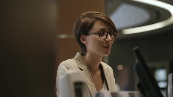 Thumbnail for Beautiful Woman Working at Service Desk in Hotel
