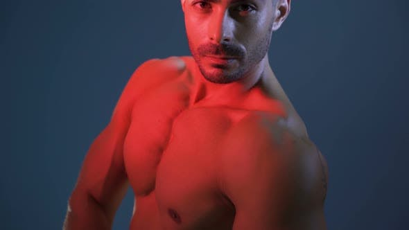 Thumbnail for Shirtless Ripped Man Posing with His Arm Down Showing Biceps and Shoulder Muscles