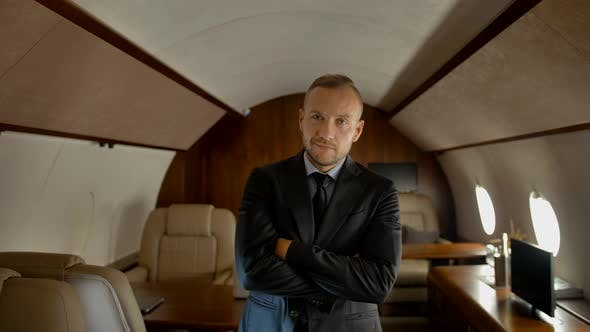 Thumbnail for Confident Businessman in Private Jet Cabin