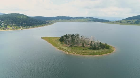 Thumbnail for Unique Island in The Middle of Big Lake with White and Green Trees on It, Batak, Bulgaria