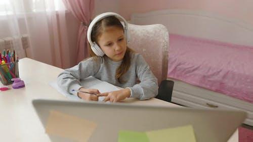Schoolgirl Girl Studies Online On Laptop At Home