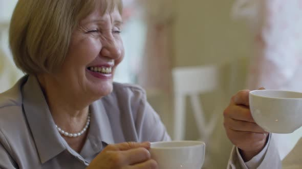 Cover Image for Senior Couple Enjoying Coffee in Cafe