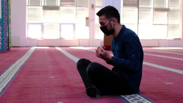 Man Masked Raising His Hands Mosque
