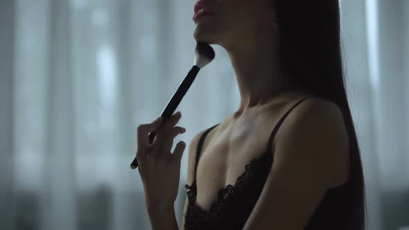 Thumbnail for Beautiful Female Seductively Brushes Skin with Cosmetics Tool, Flirting Gestures
