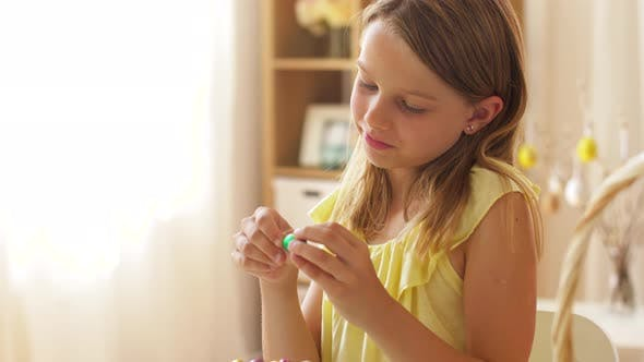 Thumbnail for Girl Removing Wrapper of Chocolate Easter Egg 14