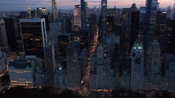 Thumbnail for Manhattan Skyline at Night with Flashing City Lights in New York City Over Central Park