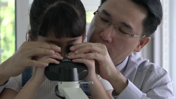 Student looking microscope