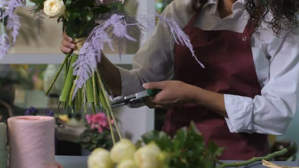 Cover Image for Florist Hands Cutting Flower Stems in Workshop