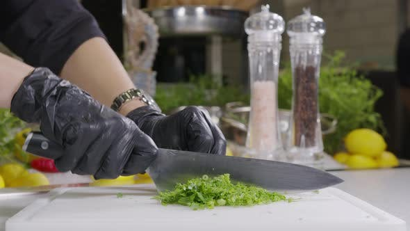 Thumbnail for Chef Chops Parsley and Dill with a Knife on the Table, Close-up