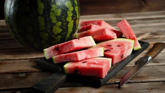 Sliced Watermelon on a Cutting Board Rotates Slowly.