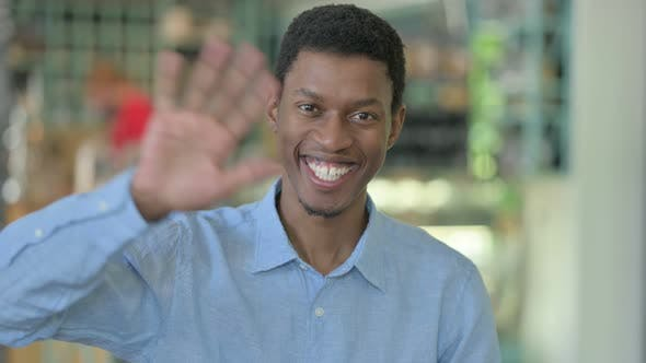 Cheerful Young African Man Waving, Hello