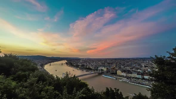 Thumbnail for Aerial View of Budapest and Danube River With Ships Under Glowing Sky at Dusk