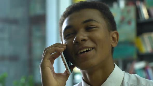 Thumbnail for Happy Student Talking on Cellphone, Boasting Good Grades, Successful Exam