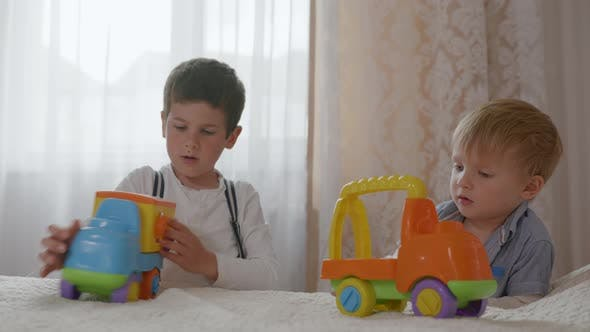 Thumbnail for Children Relationship, Cute Boys Loving Relatives Play Together with Plastic Colored Toy Cars