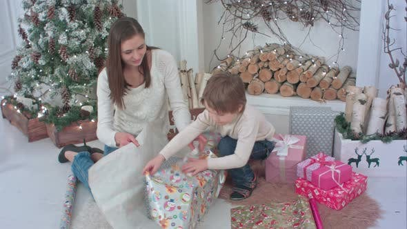 Thumbnail for Little Boy and a Young Mother Preparing Christmas Presents