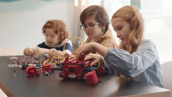 Three Children Making Tech Project