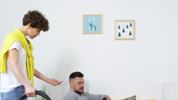 Thumbnail for Middle-Aged Caucasian Woman Vacuuming and Berating Lazy Husband