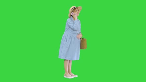 Thumbnail for Worried Pregnant Woman Talking on the Phone Having Contractions on a Green Screen, Chroma Key