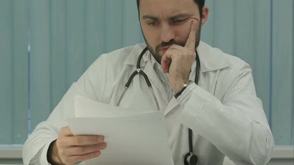 Thumbnail for Tired Medical Doctor Tired From Paper Work with Documents