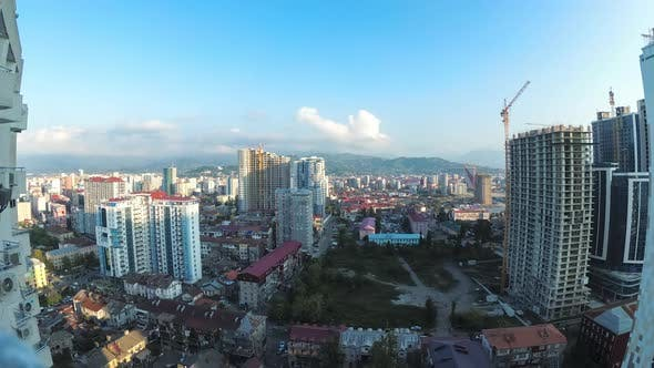 Thumbnail for City Space with Construction Site, Skyscrapers, Traffic, and Mountains. Timelapse. Batumi, Georgia
