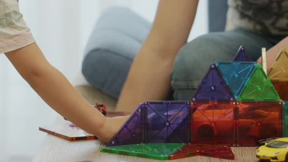 Thumbnail for Child playing with cars in a colorful garage