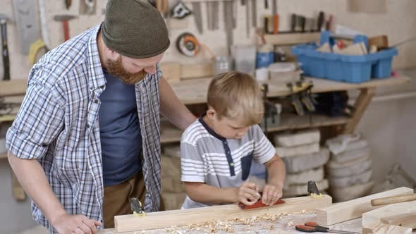 Thumbnail for Boy Working with Hand Plane
