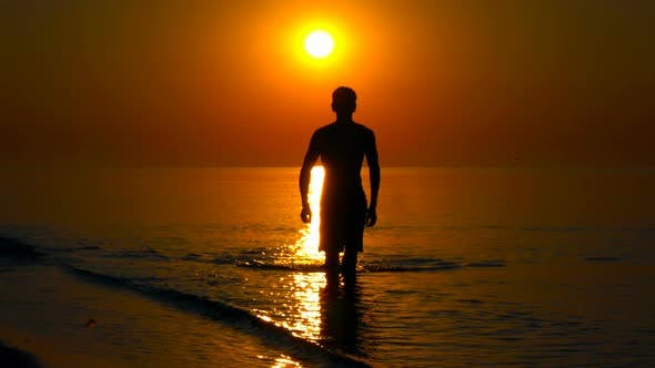 Thumbnail for young man on the background of the sea sunset