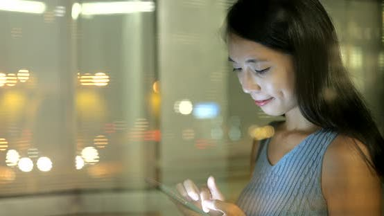 Thumbnail for Woman using smart phone in the city