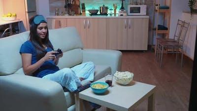 Sitting on Sofa Playing Video Game