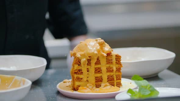 Thumbnail for Pouring a Sweet Sauce and Granola on Honey Cake