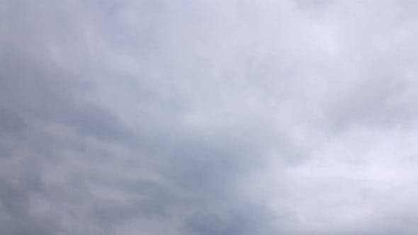 Thumbnail for Time Lapse of Stormy Rain Cloud Approach on Gray Sky