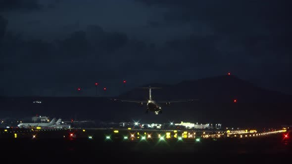 Thumbnail for A Landing Aircraft at Night