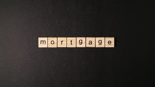 Thumbnail for Wooden Cubes Open And Sets Up A Word Mortgage