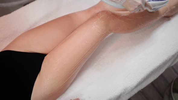Thumbnail for Beautician Doing Laser Hair Removal on Slim Legs Beautiful Woman in Beauty Salon