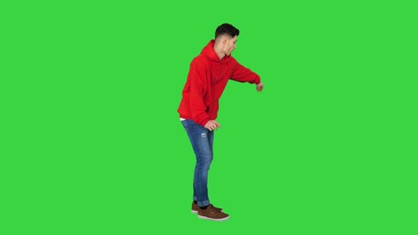 Thumbnail for Handsome Young Man Dancing in Red Hoody on a Green Screen, Chroma Key