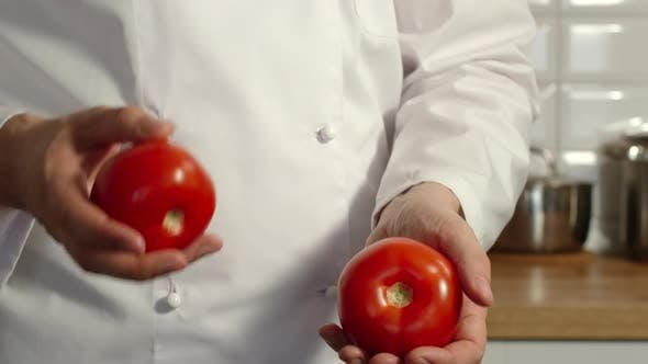Thumbnail for Chief-Cooker Juggles A Red Tomatoes In A Kitchen