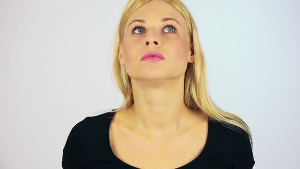 Thumbnail for A Young Attractive Woman Uncovers Her Eyes and Looks Around in Confusion - White Screen Studio