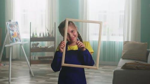 Little Girl Artist Is Posing On Camera
